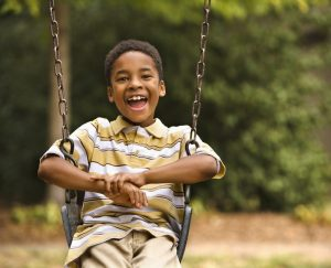 Boy in swing at park